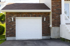 Garage. Next to the entrance to a small  detached house Royalty Free Stock Image
