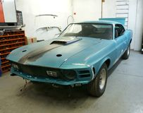 Garage. Picture of vintage Mustang under restoration in a restoration shop.- 1970 Mustang Mach1 Stock Image