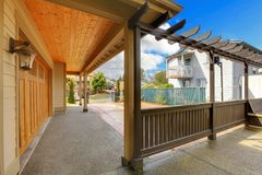 Garage and back porch with driveway. New luxury home exterior. Stock Image