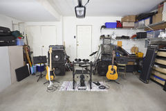 Garage Band Music Equipment. Rock band music equipment in a cluttered suburban garage Stock Photography