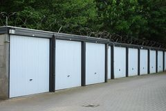 Garage boxes for rent. Some white garage boxes for rent in the Dutch city of Almelo Stock Images