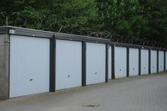 Garage boxes for rent. Some white garage boxes for rent in the Dutch city of Almelo Stock Photo
