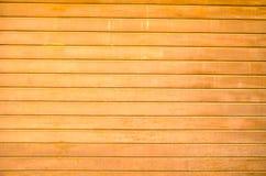 Garage door. Garage bright wood door close up photo Stock Photos