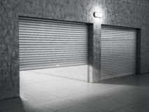 Garage building made of concrete. With roller shutter doors stock images