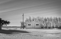 Garage or building in winter. White building or garage in snow on a cold winter day Royalty Free Stock Images