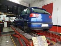 Garage car alignment balancing. Garage car repair alignment balancing stock image