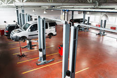 Garage with cars on service or repairing top view Stock Photos