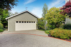 Garage with concrete driveway Royalty Free Stock Images