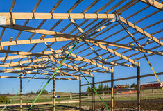 Garage construction in suburbia, USA. Closeup. Roof view. Wood, wooden roof truss system. Suburban building. Garage construction, USA. Closeup. Roof view. Wood Stock Photos