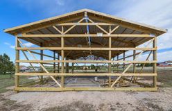 Garage construction in suburbia, USA. Wood, wooden roof truss system. Gray corrugated metal cladding panel on the roof. Garage. Wood, wooden roof truss system Royalty Free Stock Photos