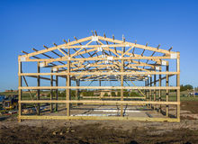 Garage construction in suburbia, USA. Wood, wooden roof truss system. Suburban building. Garage construction. Wood, wooden roof truss system. Suburban building Royalty Free Stock Images
