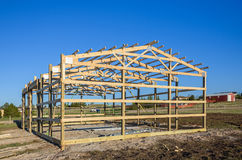 Garage construction in suburbia, USA. Wood, wooden roof truss system. Suburban building. Stock Image