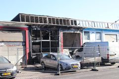 Garage destroyed by fire on the Melkwegstraat in industrial zone Binckhorst in The Hague the Netherlands. Garage destroyed by fire on the Melkwegstraat in royalty free stock images
