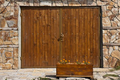 Garage Door. And flower pot in Sozopol, Bulgaria Royalty Free Stock Photos