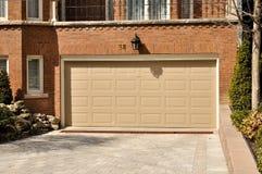 Garage Door. Door to garage beneath modern townhome Stock Photos