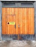 Garage door. Wood garage door with brass letters Stock Photo