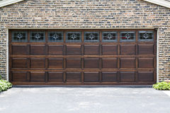 Garage Door. Dark Wooden Garage Door with brick wall background stock photography