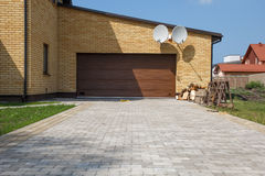 Garage door. New house garage door with a paved paths stock photo