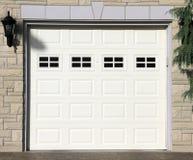 Garage Door. A white garage door of a detached house stock image