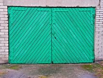 Garage door. Closed wooden aqua garage door stock photos