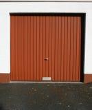 Garage door. A brown garage door in the sun Royalty Free Stock Photo