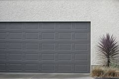 Garage door. Grey garage door positioned on a garage Royalty Free Stock Photography