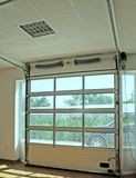 Garage door. Modern white garage door with windows royalty free stock photos