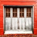 Garage door in an alley in autumn Stock Photo