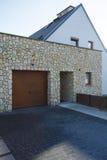 Garage door and brick entrance. Wooden garage door and brick entrance of big modern house stock photo