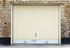 Garage door. On brick wall stock image