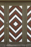 Garage door with brown, white and red diamond pattern Stock Images