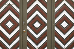 Garage door with brown, white and red diamond pattern Stock Photo