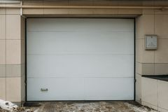 Garage door for car parking in house. Exterior royalty free stock photography