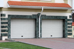 Garage door for 2 cars. Marble royalty free stock images
