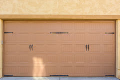 Garage Door. Close up of brown and tan exterior garage door stock photos