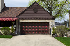 Garage door. Double brown wooden garage door with ornaments royalty free stock photos