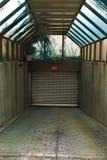 Garage Door. Garage entrance covered with a visor in a dark tunnel Stock Photos