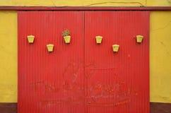 Garage door and flowerpots Stock Photos