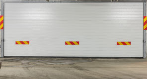 Garage door. Garage metal roll up door stock photo