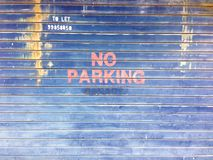 No parking sign in front of garage stock photography