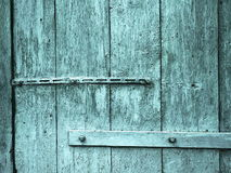 Garage door old decoration on metal hinges Royalty Free Stock Photo