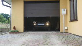 A garage door opens automatically car move