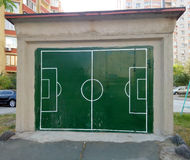 Garage door painted in the football field Stock Image