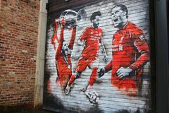 Garage door painting of FC Liverpool football players, Liverpool, England.