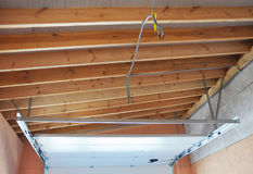Garage Door Post Rail and Spring Installation Assembly and Garage Ceilling. Royalty Free Stock Photo