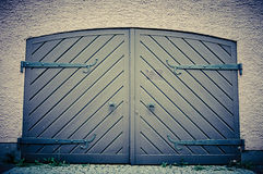 Garage door in retro vintage colors. Double sided doors of modern garage in a building. Royalty Free Stock Image