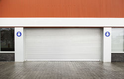 Garage door on the street. Detail of a metal closed royalty free stock image