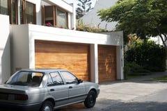 Garage door. A wooden garage door on a sunny day in Lima, Peru stock images