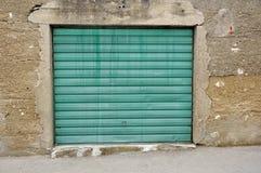 Garage doors. Old green garage doors, horizontal photo Stock Photo