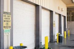 Garage Doors. Four garage doors to an auto mechanic shop in Fresno, CA Stock Images